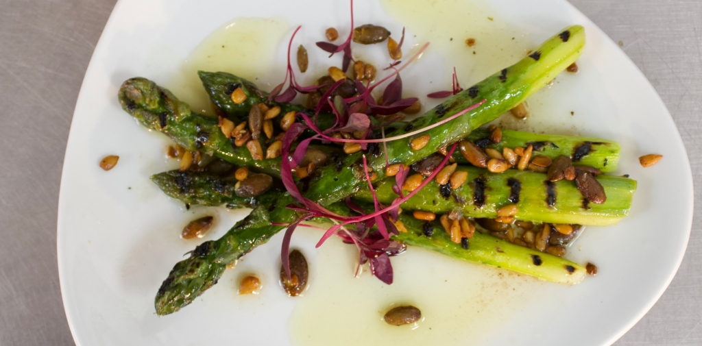 Grilled asparagus, burnt butter, pumpkin seeds at NOPI