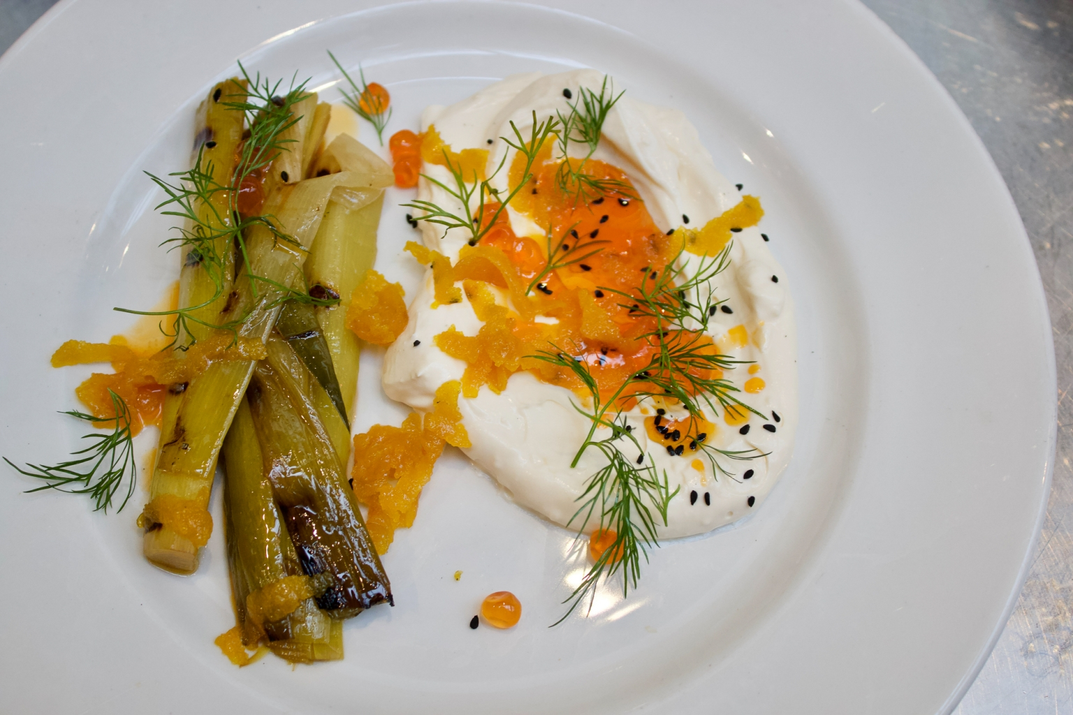 Charcoal grilled leeks with labneh, chilli butter, bottarga and dill at Moro.